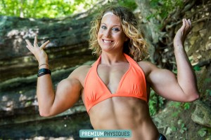 Cute Cheerleader, gymnast, and bodybuilding champ, Alli Schmohl, with the HUGE arms - join PremiumPhysiques now!