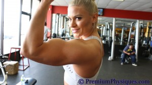 Tanya Hyde flexing her killer biceps and triceps at Aussie Fit Gym - Join PremiumPhysiques.com now!